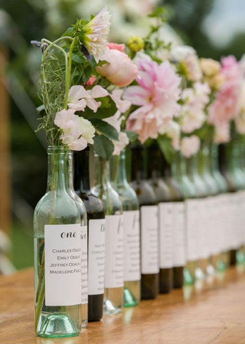 The table plan was made using old wine bottles in all colours at this London wedding venue