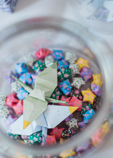 Origami cranes and stars were placed in glass jars for a decorative touch – diy wedding ideas