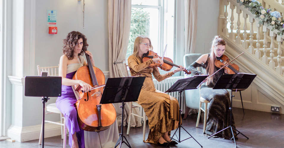 A string trio played music throughout the wedding ceremony, wedding reception and evening