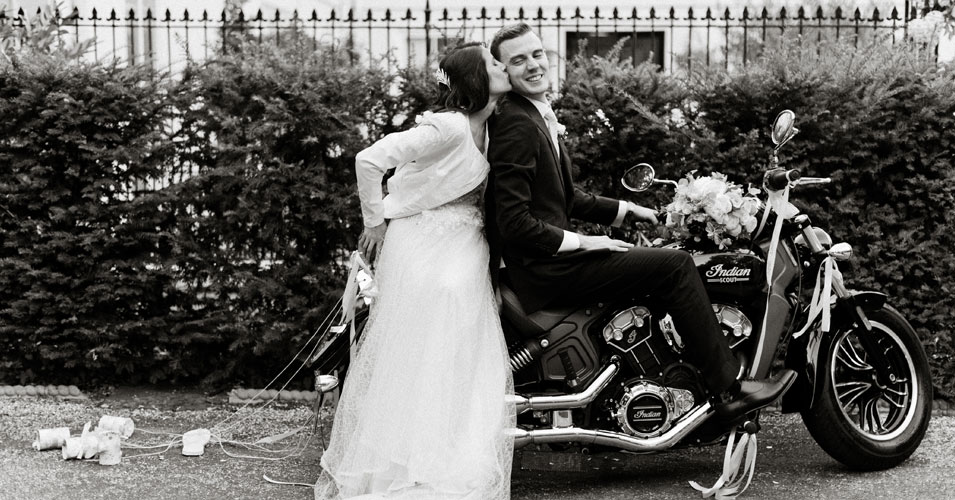 Couple have a photo on a motorbike