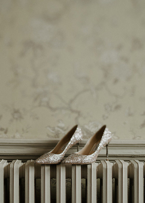The bride chose sparkly Jimmy Choo wedding shoes to accompany her wedding dress