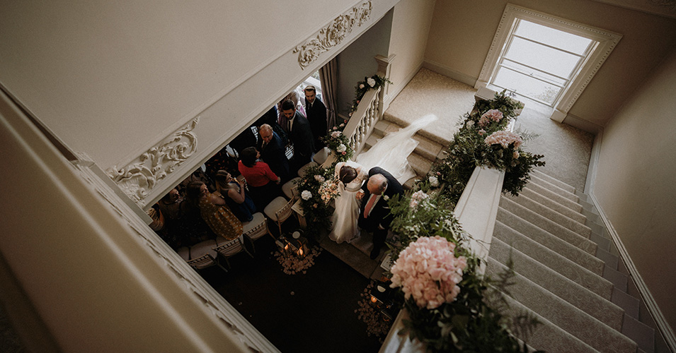 The bride makes her way down the grand staircase