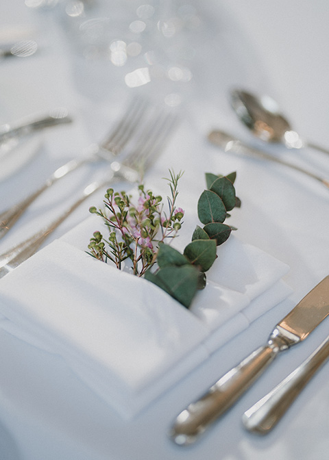 The couple displayed a single eucalyptus on each place setting