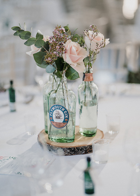 Gin bottles featured single roses and eucalyptus as the centrepieces