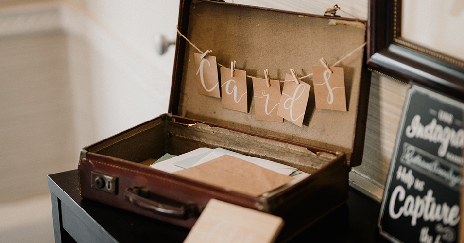 Wedding cards from guests were displayed in a vintage suitcase